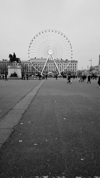 Place Bellecour In The Street Black And White The Big Wheel Attraction Merry Go Round Fun City Life Giant Wheel City View  People And Places Monochrome Photography