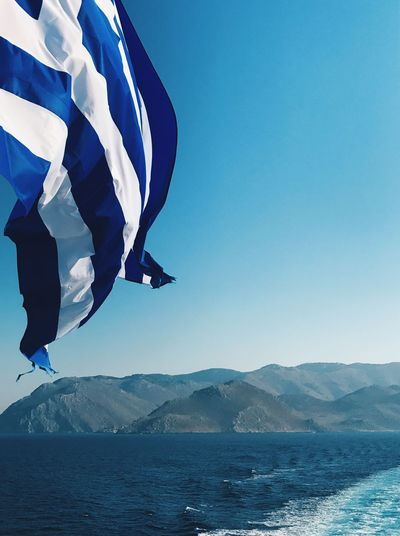 Greek flag Mountain Blue Day Wind Sea Outdoors Mountain Range Mid-air Water Flag Clear Sky Nature Flying Scenics Sky Beauty In Nature Symi ısland No People Greece Greek Flag