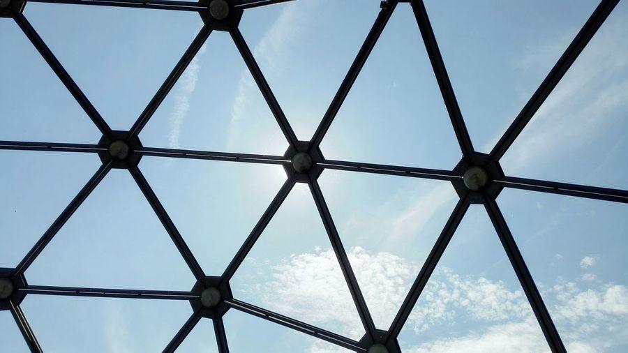 Full frame shot of sky seen through patterned glass window