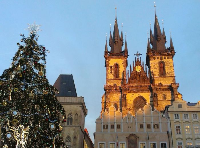 Prague Old Town Square at Christmas with Christmas decorative tree. Travel Destinations Architecture City Tower Igniting Sky Built Structure Tree Tourism History Christmas Tree Illuminated Clock Tower Night Outdoors Old Town Square Prague Czech Republic Christmas Lights Market Marketplace