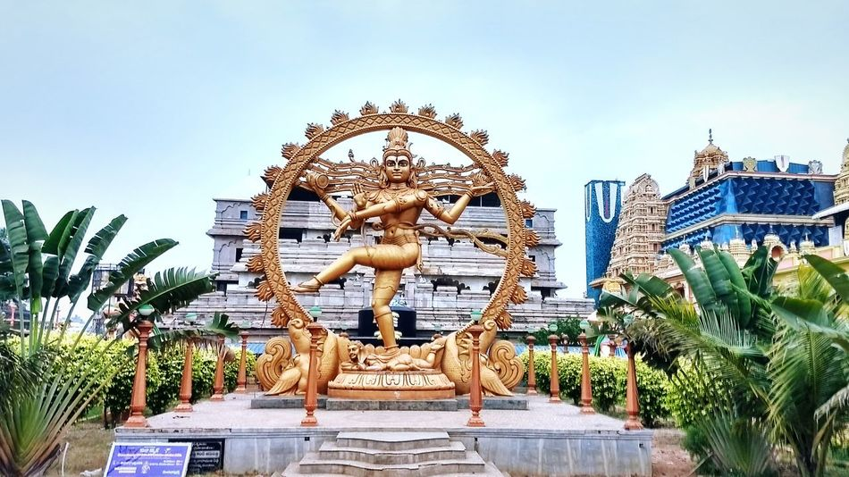 Good morning guys... At A Temple Lord Shiva Dancing God's Beauty God Is Great. God Evening Andhrapradesh Andhra Temple Temple Architecture Temple Art Sculpture Sculpture Of Lord Shiva Nature Greenery Outdoors Coconut Trees Go For Green 💚 No People Landscape Moto Mobile Shots Travel Destinations Architecture