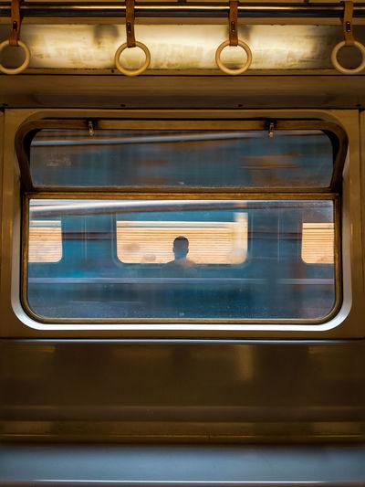 Man Seen Through Train Window