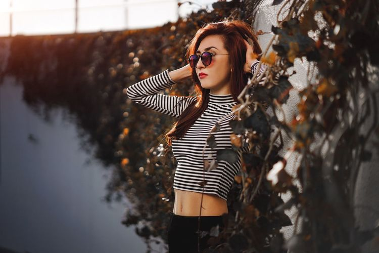 Young Adult Striped Young Women One Person Casual Clothing Beautiful Woman Fashion Leisure Activity Real People Lifestyles Beauty Standing Outdoors Women Adult People Close-up One Young Woman Only Fashion Model Day