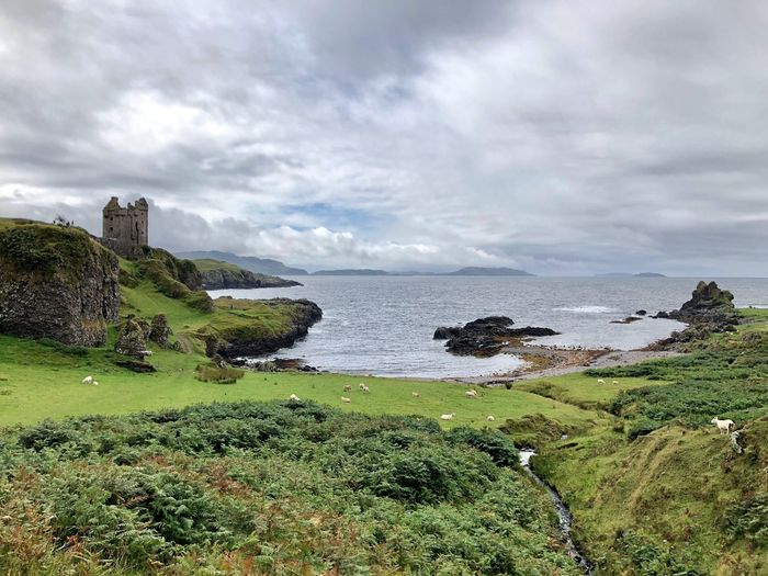 Wonderful Green Color Scotland Abandoned Ruins Castle Water Cloud - Sky Sky Sea Beauty In Nature Scenics - Nature Plant Land Beach Nature Tranquility Green Color Tranquil Scene Day Grass No People Outdoors Horizon Over Water Growth