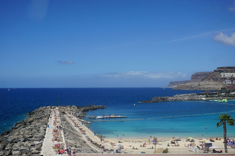 amadores beach Sea Beach Amadores Gran Canaria City Water Sea Beach Blue Sand Summer Relaxation Wave Sky Seascape Horizon Over Water Coastal Feature Rocky Coastline Ocean Stack Rock Coastline Bay Of Water Beach Umbrella Lifeguard Hut Calm Coast