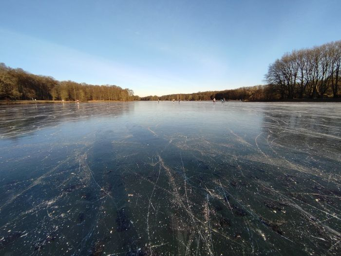 Scenic view of frozen lake against sky