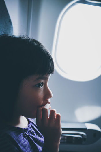 Close-up of girl traveling in airplane