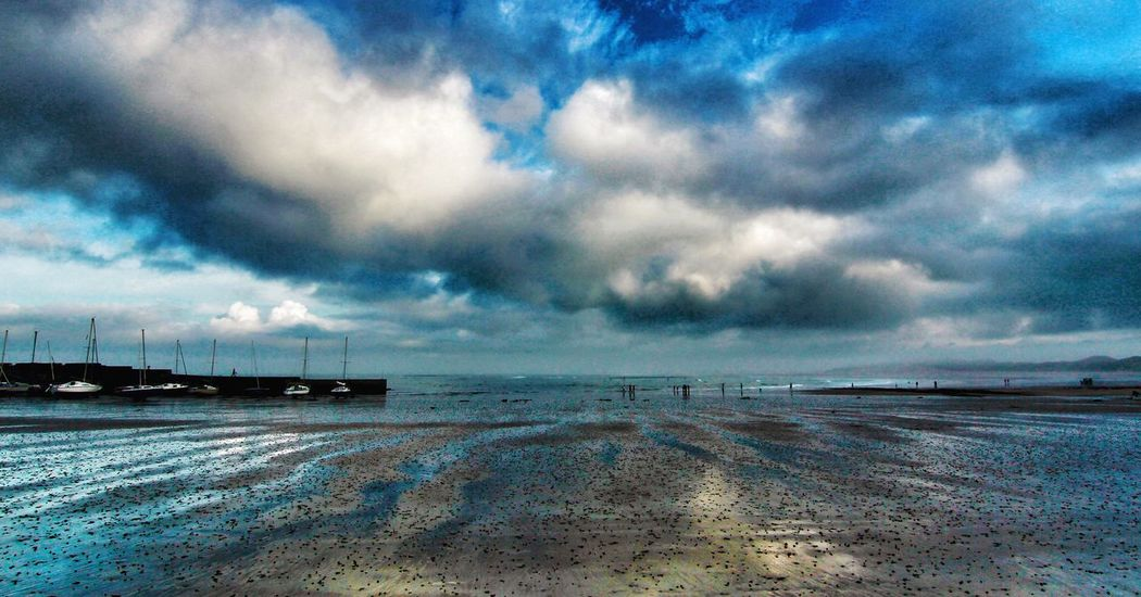 Cloud - Sky Sky Scenics Sea Nature Tranquility Beauty In Nature Water Tranquil Scene Weather Outdoors No People Cold Temperature Beach Day Horizon Over Water