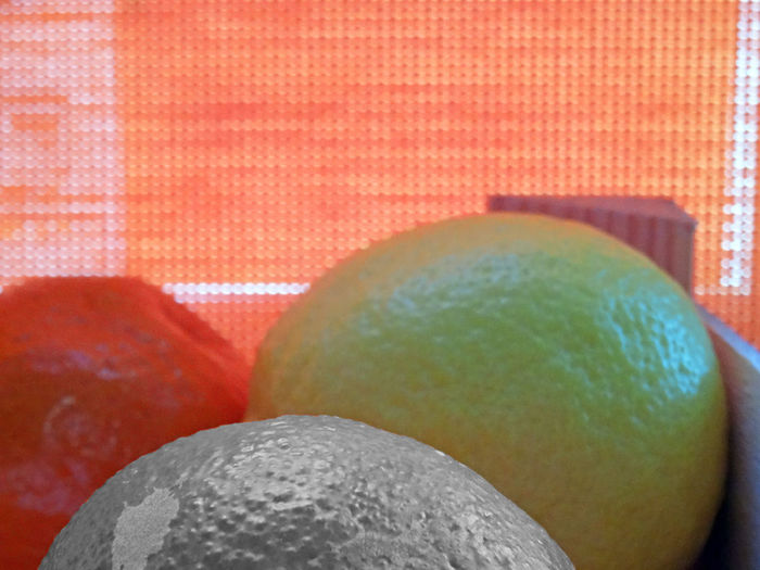 One BnW fruit textured in foreground with other colored fruits Fruits One Bnw Clementine Yellow And Orange Citrus Fruits Lemon Close Up Against Colored Background Fruits Shoot Edited Fruit Close-up
