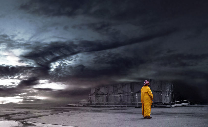 Composite image of storm clouds with construction site and construction worker in yellow rain jacket and safety helmet at a construction site Futuristic Global Warming Storm Vortex Adult Afterlife Apocolyptic Cloud - Sky Dystopian Future Global Warming Effect Global Warming Storm One Man Only One Person Safety Sky Storm Storm Cloud Storm Global Storm Global Warming Tornado Tornado Global Warming Vornado Weather Weather Global Warming Yellow