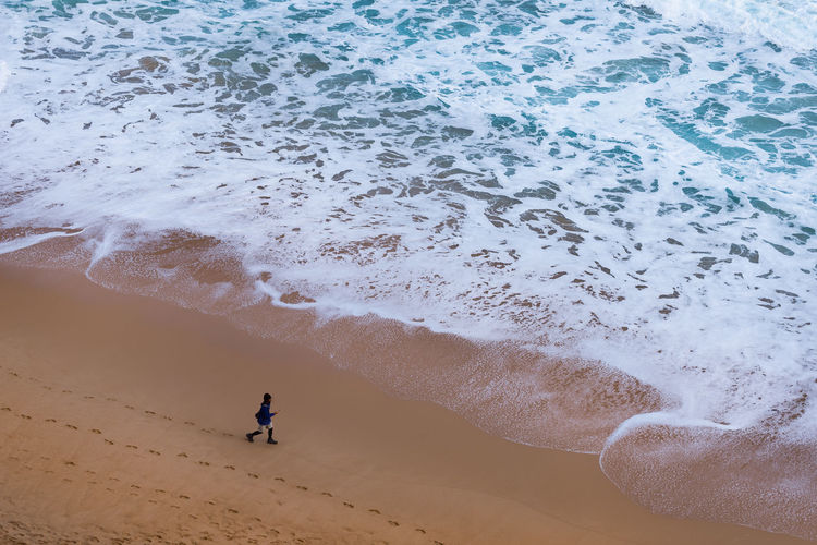 Aerial view of boy on beach
