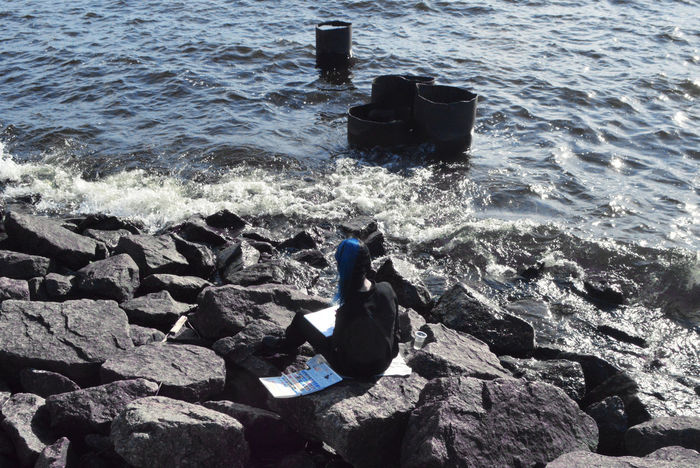 Saint Petersburg Beauty In Nature Day Full Length Gulf Nature One Person Outdoors People Real People Rock - Object Sea Sitting Water Wave