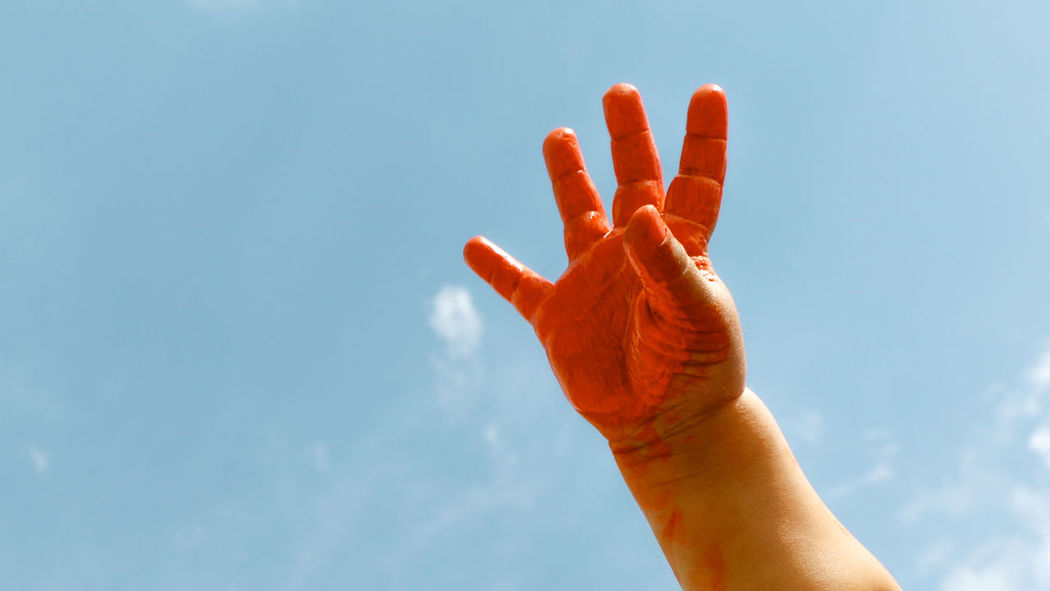 Hand Orange Painting Bluesky Orange By Motorola Streetphotography People Life Small The Amazing Human Body