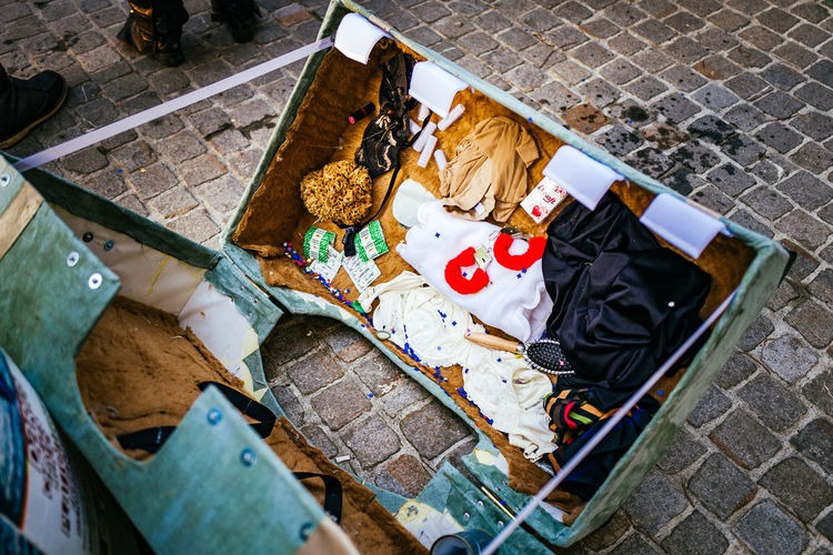 High angle view of abandoned suitcase on footpath