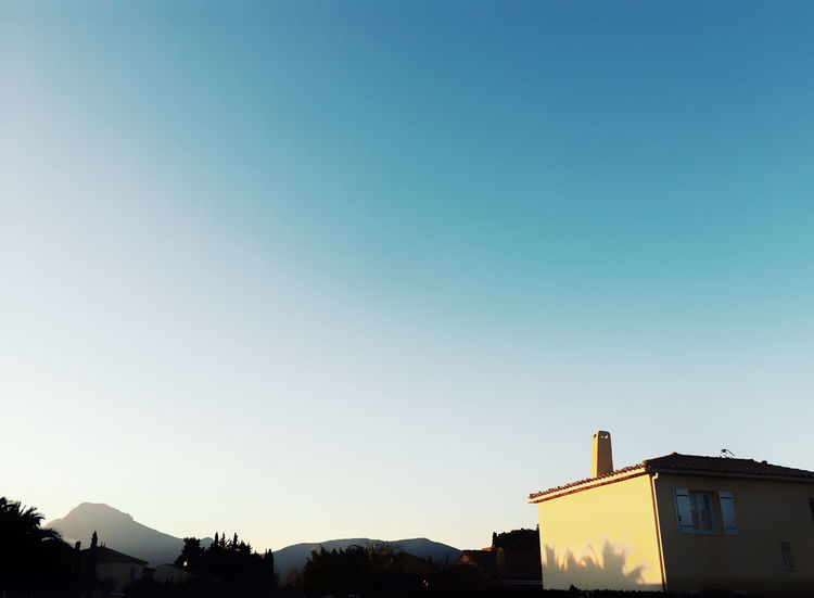 La Crau is dope Sky Gradient Building Exterior Architecture Built Structure Copy Space Building Clear Sky Nature No People Blue House Residential District Outdoors Low Angle View Silhouette Day Dusk Sunset High Section City