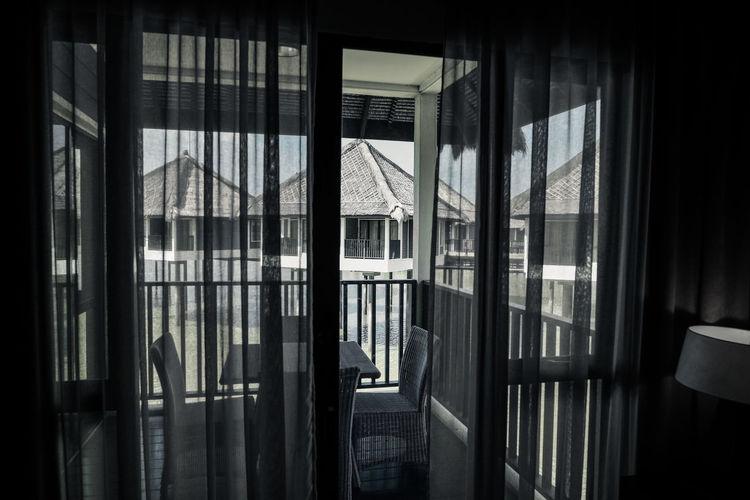 Furniture Seen Through Window Of Tourist Resort