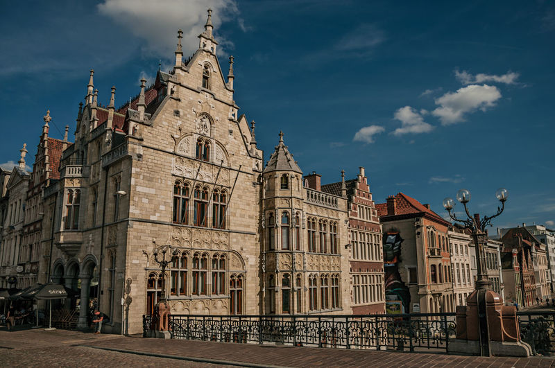 St. michael bridge and gothic buildings in ghent. a city full of gothic buildings in belgium.