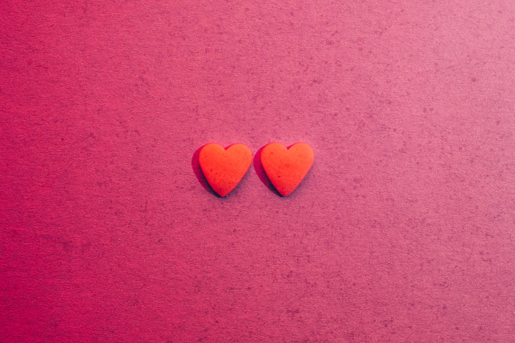 Close-up of heart shape on pink background