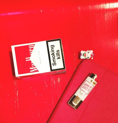Exploring Random Taking Photos Red Theme Red Stool Ipad Malboro Hello Kitty Lighter Red Communication No People Fire Alarm Close-up Text Indoors  High Angle View Red Background Still Life