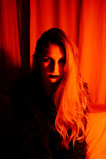 Portrait Indoors  Red Color Red Light Dark Women Portrait Of A Woman Sinister Hair Young Women Looking At Camera Beautiful Woman Witch Spooky Long Hair Headshot Ominous Twin Peaks Gloomy Serious Eyes Hairstyle Illuminated