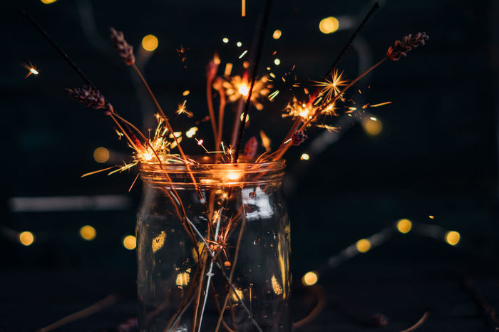 Close-Up Of Illuminated Sparkles Illuminated Celebration Night No People Glowing Motion Lighting Equipment Sparkles Lights Christmas Lights Sparks Indoors  Electricity  Decoration Celebration Event Holiday Christmas Decoration Focus On Foreground Sparkler Light Christmas Close-up Copy Space Bottle