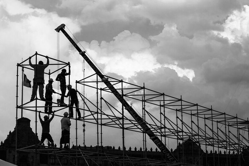 Constructing a sky Growing Better Clouds And Sky Blackandwhite Urban Geometry Streetphotography Geometric Shapes Black & WhiteSilouette & Sky People