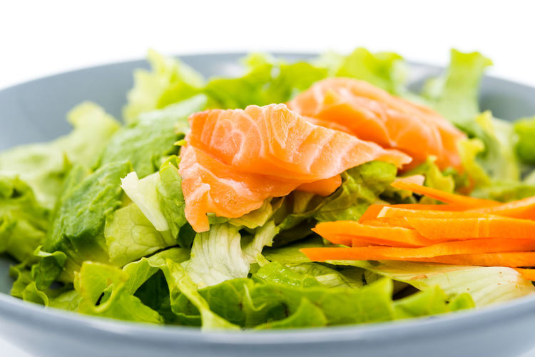 Close-Up Of Green Salad With Salmon In Bowl
