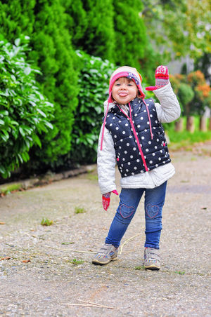 Waiting for the autumn. A little girl in happy colors. Autumn Childhood Childhood Moments Cold Day Colorful Clothing Crawl Crawling Crawling Little Girl Gloves And Helmets Happiness Happy Colors Kids Photo Kids Photography Loll Loll Out Warm Clothing Woolen Woolen Cap Woolen Gloves Woolly