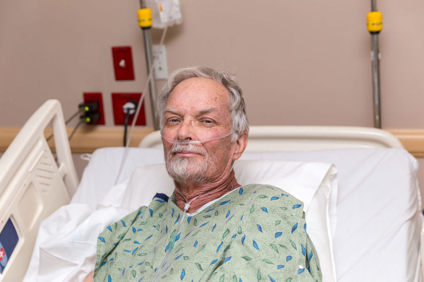 Elderly man in hospital bed with oxygen tube. Stoic expression of dealing with pain. CHEMO  Cancer CancerSucks Grandfather Healthcare Hospital Hospital Bed Pain Wellness Cancer Awareness Cancer Survivor Cancerawareness Chemotherapy Elderly Elderly Man Grandpa Gray Hair Health Healthcare And Medicine Hospital Patient Real People Senior Adult Senior Men