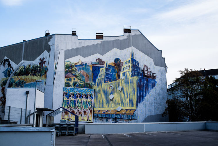 Berlin Graffiti Architecture Art And Craft Building Exterior Built Structure City Creativity Germany Graffiti Art Modern Multi Colored Mural No People Outdoors Reflection Residential District Sky