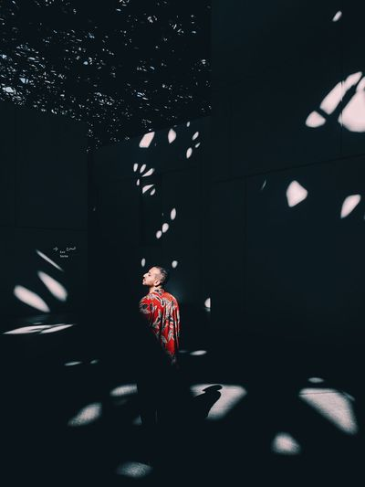 Midsection of man standing in illuminated building