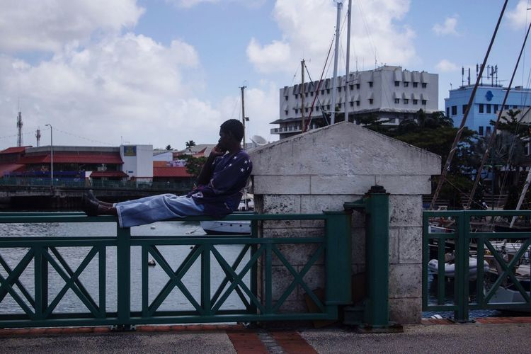 Bridgetown, Barbados Sky Real People Men One Person Lifestyles Full Length Railing Outdoors Cloud - Sky Day City Architecture Relax Relaxing Chilling Port Portrait Bajan Barbados Relaxing Moments Tranquility Ocean Carribean Carribbean Sea