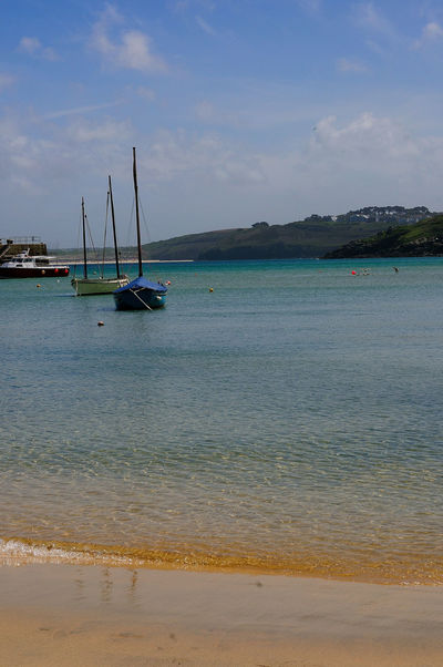 St. Ives Cornwall Anchored Beach Beauty In Nature Cloud - Sky Day Land Mast Mode Of Transportation Nature Nautical Vessel No People Outdoors Sailboat Sand Scenics - Nature Sea Sky Tranquil Scene Tranquility Transportation Travel Water Yacht