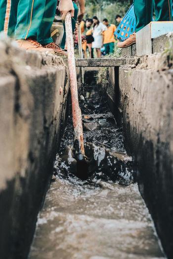 Volunteer Water Pipe Drainage Channel Dredge Dredger Flowing Water Group Of People Hoe Low Section Maintenance Maintenance Engineer Plumber Plumber At Work Water