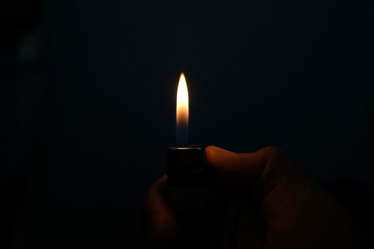 Flame Fire Burning Fire - Natural Phenomenon Heat - Temperature Dark Illuminated Close-up Black Background Holding Indoors  Human Hand Nature One Person Darkroom Hand Glowing Candle Human Body Part Domestic Room Finger Melting