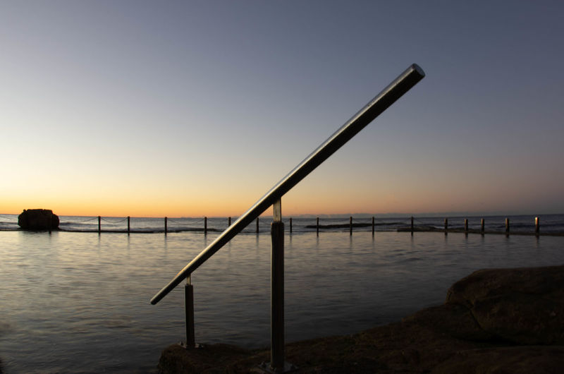 Architecture Beach Beauty In Nature Built Structure Clear Sky Idyllic Nature No People Outdoors Pier Scenics - Nature Sea Silhouette Sky Sunset Tranquil Scene Tranquility Water Wooden Post