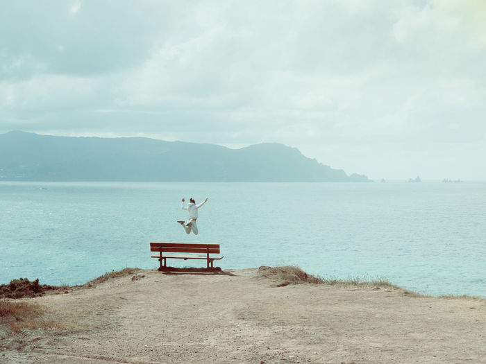 To be free Bench Cliffs Cloud Coastline Freedom Girl Island Jumping Ocean Outdoors S Seascape