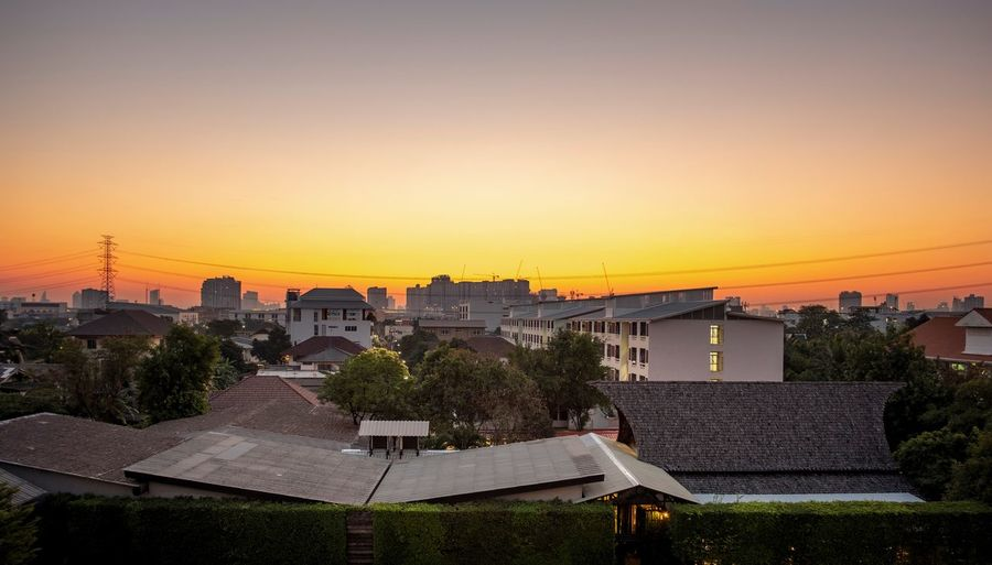 Morning bangkok Sunrise Bangkok Sky Sunset Architecture Building Exterior Built Structure Building Tree Plant Copy Space City High Angle View Clear Sky Outdoors Cityscape Orange Color House
