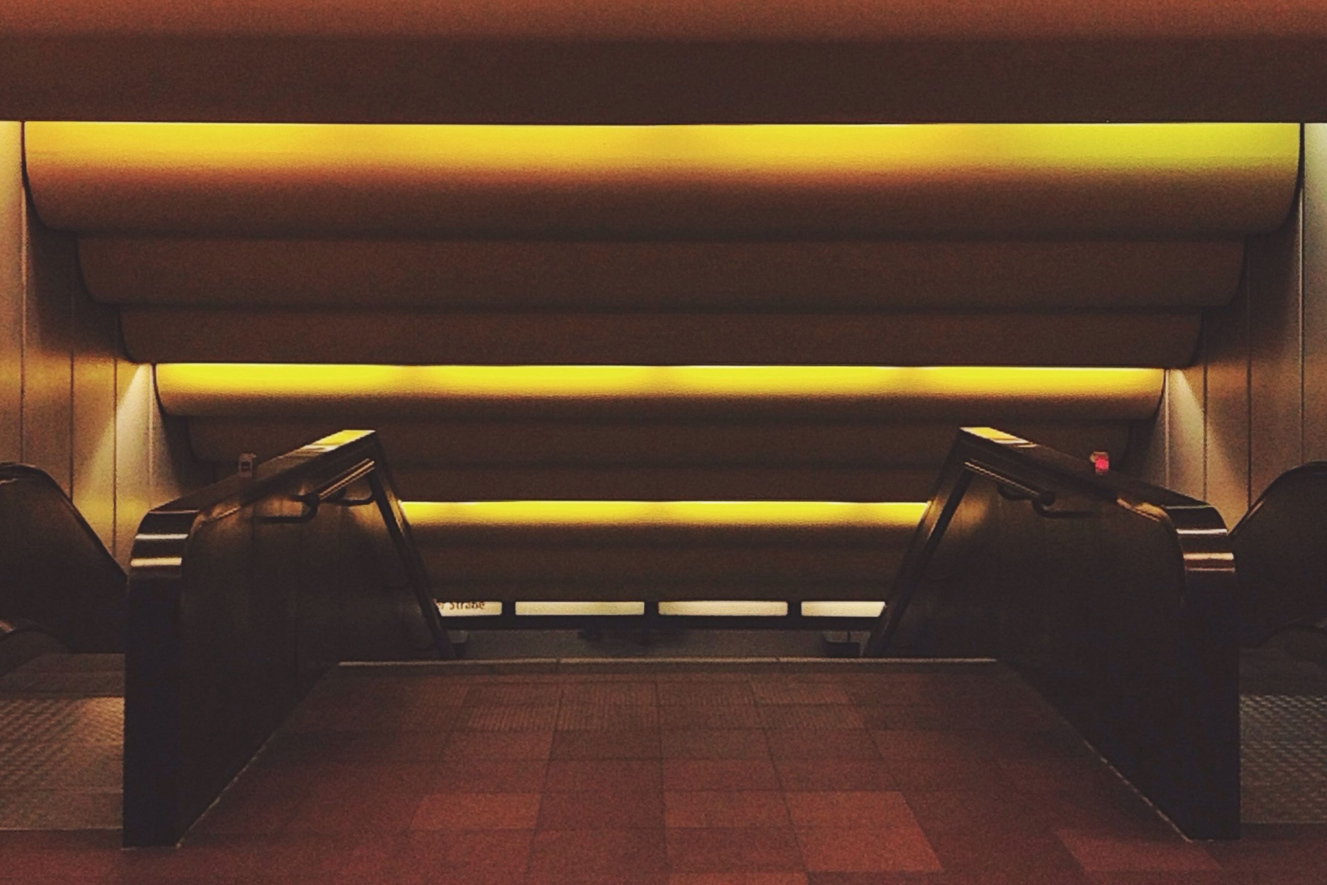 indoors, steps, steps and staircases, staircase, railing, high angle view, built structure, architecture, no people, empty, absence, wall - building feature, pattern, flooring, escalator, sunlight, day, yellow, transportation, seat