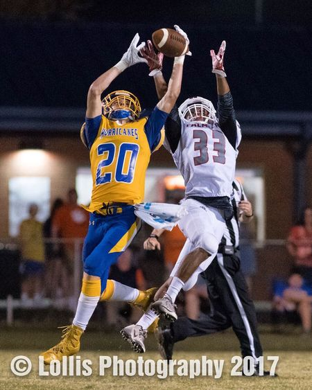 A Wren Hurricanes defender intercepts a pass intended for a Palmetto Mustangs receiver on September 22. Wren Hurricanes Palmetto Mustangs High School Football Sports Photography