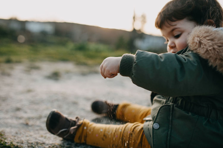Child playing with sand
