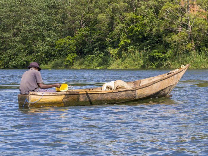 Man on boat sailing in river