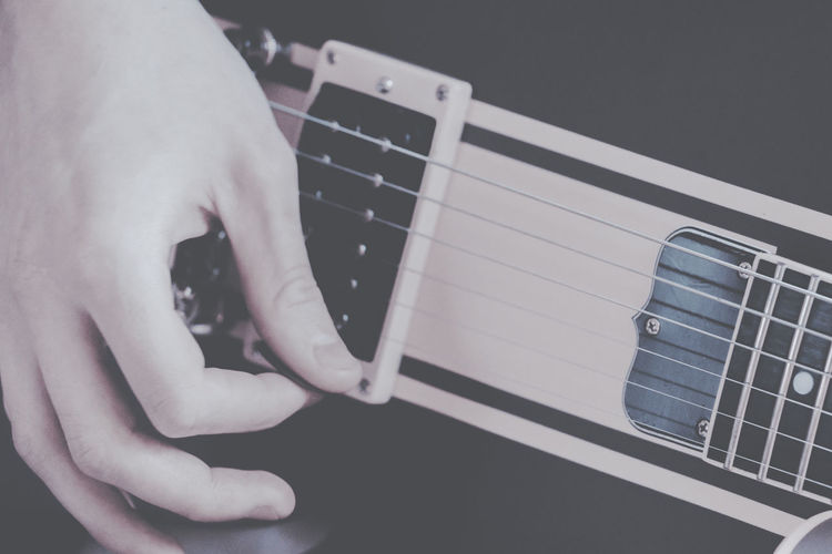Guitar playing Arts Culture And Entertainment Close-up Day Electric Guitar Fretboard Guitar Human Body Part Human Hand Indoors  Men Music Musical Instrument Musical Instrument String Musician One Person People Playing Plucking An Instrument Real People Strumming