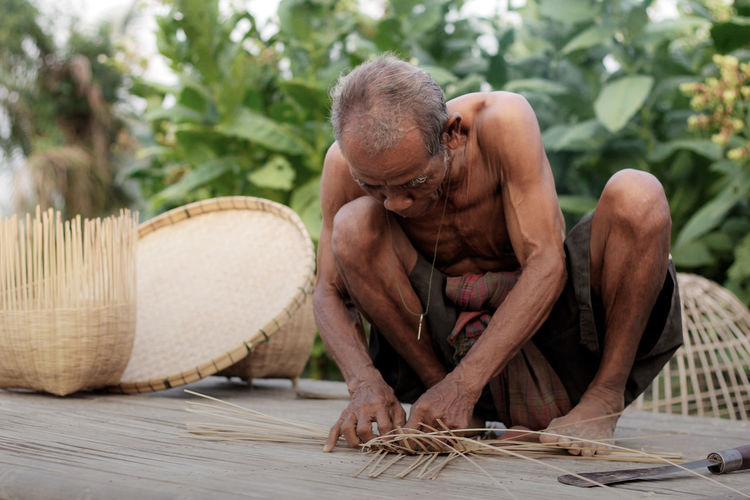 Senior Man Making Wicker Basket
