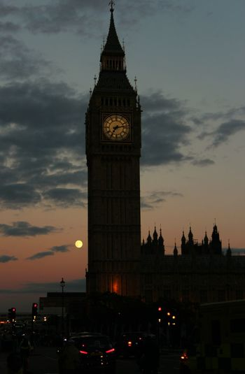 Silhouette of big ben against cloudy sky