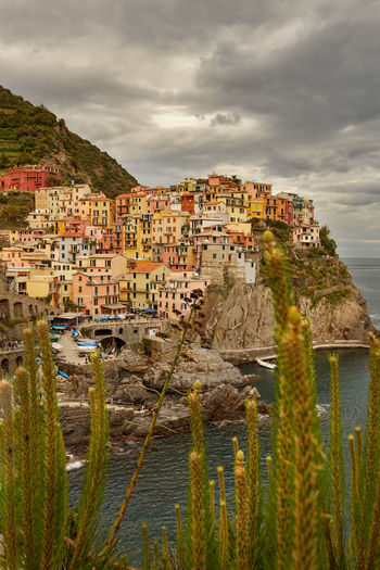 Architecture Building Building Exterior Built Structure City Cityscape Cloud - Sky Day House Land Manarola Mountain Nature No People Outdoors Plant Residential District Sea Sky Town TOWNSCAPE Water