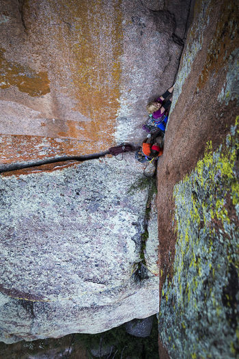 Pamela Shanti-Pack climbing a new route in Vedauwoo, Wyoming. Rock Climbing Climbing Sport Rock Extreme Sports Solid Rock - Object Adventure Leisure Activity Rock Formation Challenge Strength Determination Activity People RISK Full Length Rope Day Effort Skill  Rock Face Outdoors Conquering Adversity Safety Harness