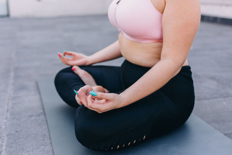 Low section of woman sitting outdoors