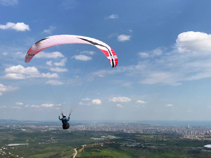 Parachute Adventure Parachute Paragliding Extreme Sports Sport Flying Leisure Activity Mid-air Joy Lifestyles Transportation Sky Nature One Person Real People Unrecognizable Person Cloud - Sky Day Gliding Freedom