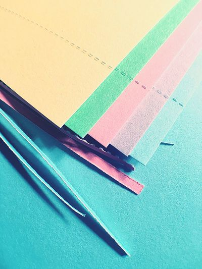 High angle view of multi colored papers on table